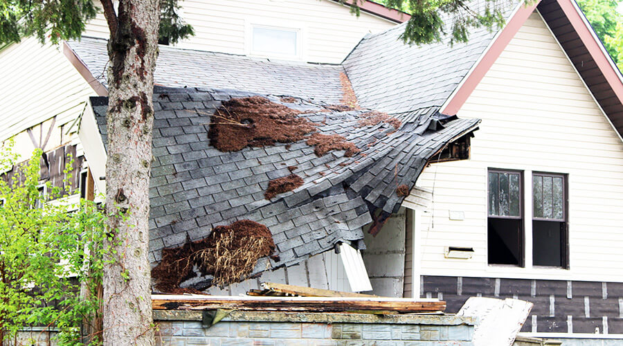 house with collapsed roof
