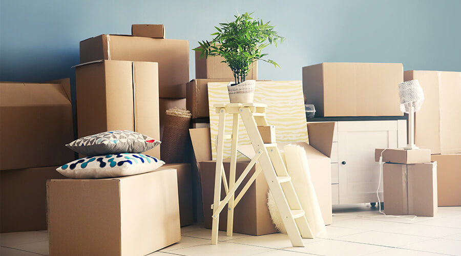 belongings stacked in room moving house