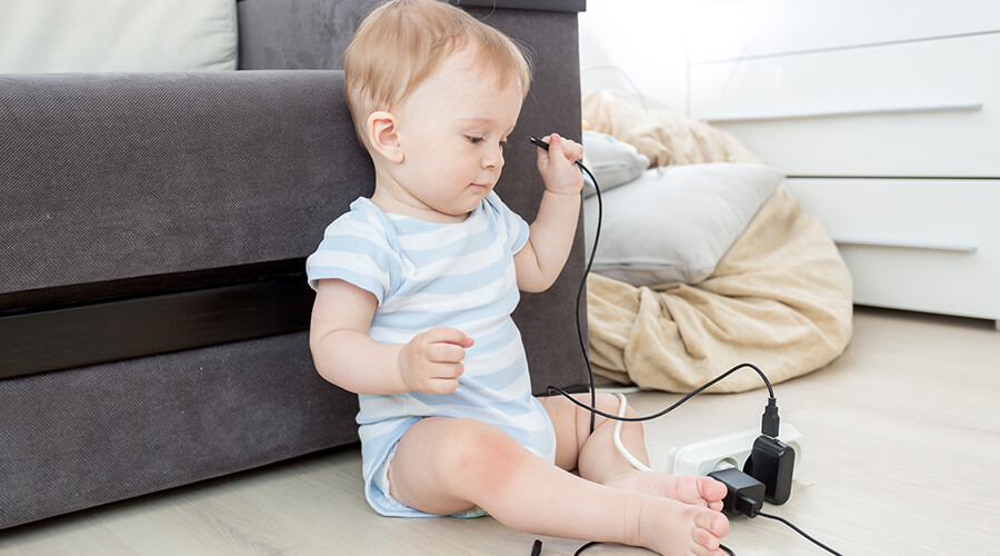 baby playing with wires