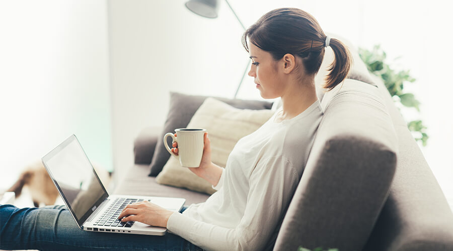 woman sitting on laptop