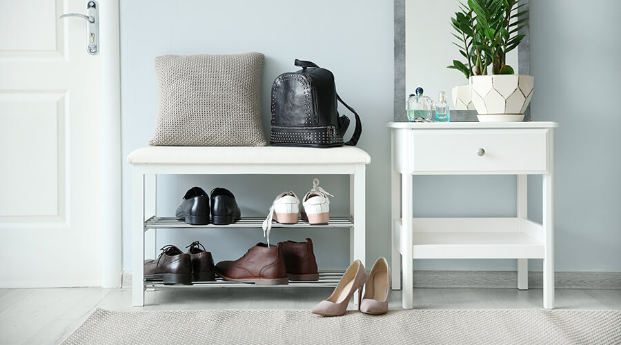 shoe rack with shoes and handbag
