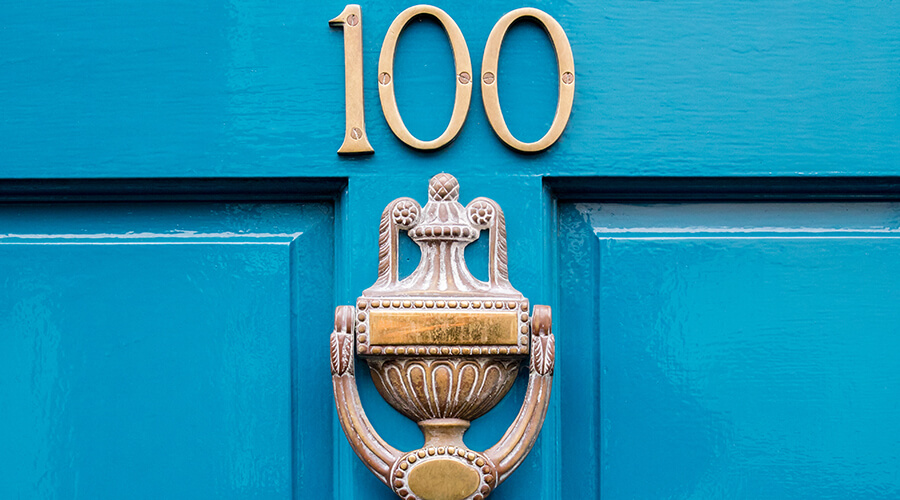 house number on bright door