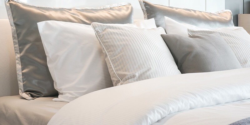 cushions on white bedding