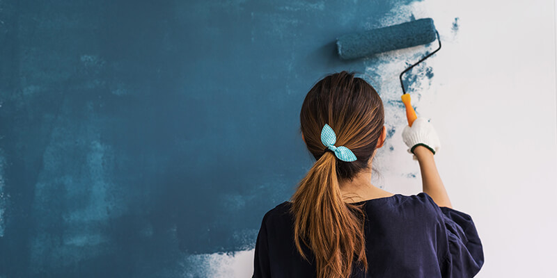 Girls painting walls